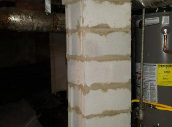 Cement piers installed inside a residential crawl space